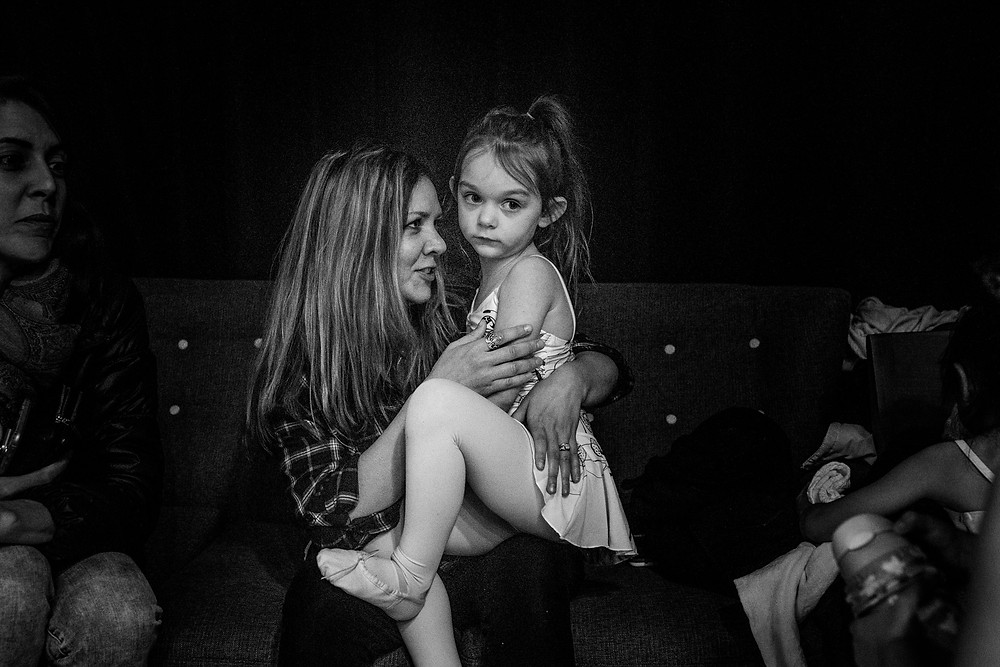 Little dancer on her mother's lap