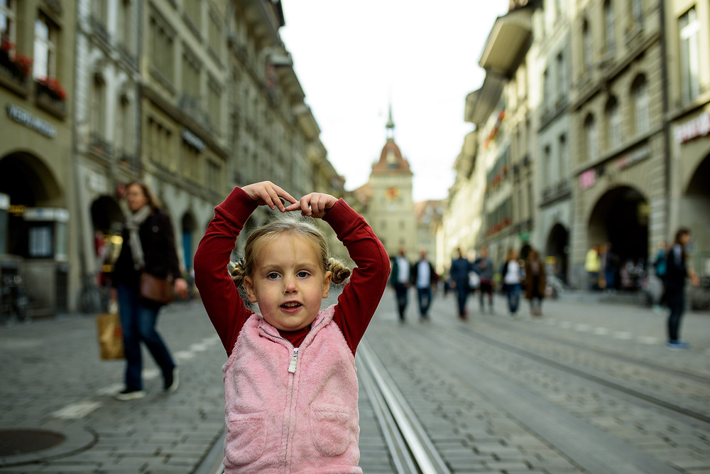 girl pirouettes through Bern, Switzerland