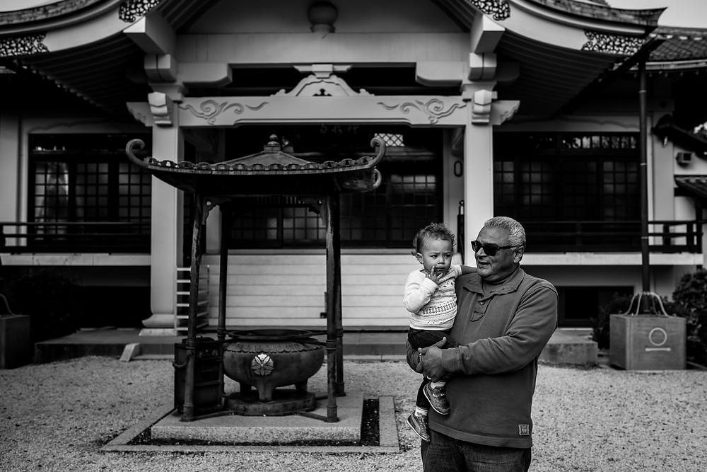 Pipa holds Giuliana at the shrine