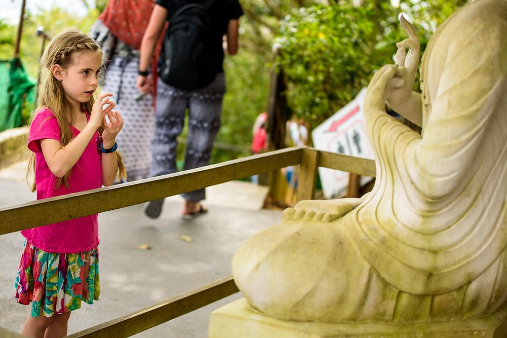 Amelia mimicking Buddha