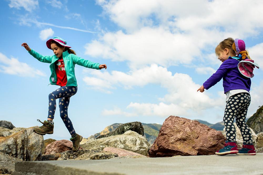 skye and Amelia jumping rocks