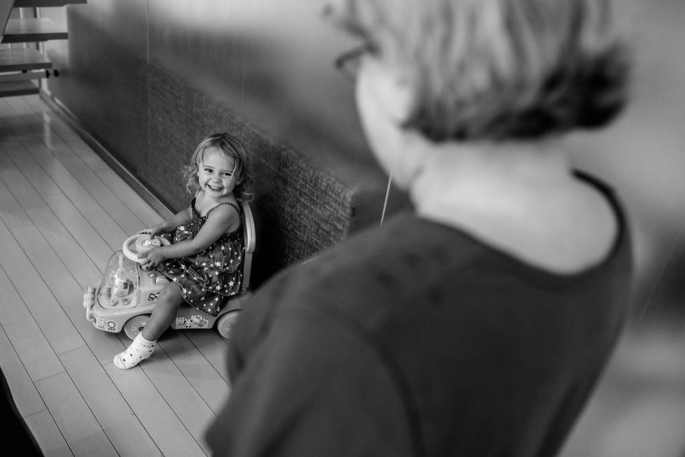 Anna Bella smiles at her grandma
