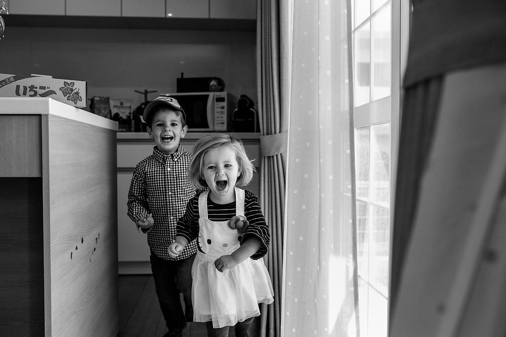Clara and Parker run wildly through the kitchen