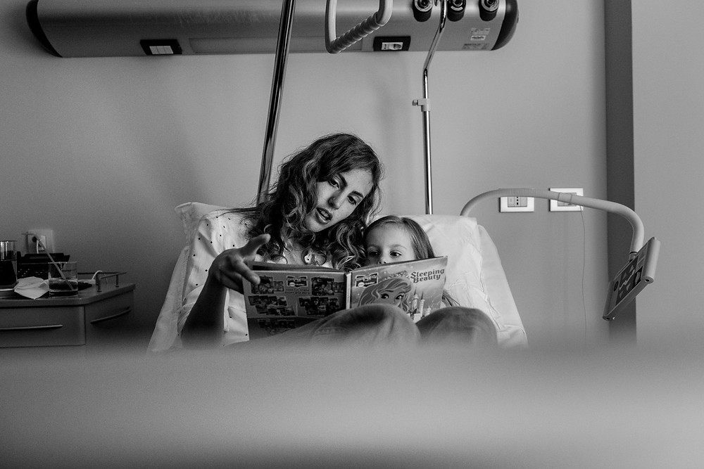 mom and daughter reading together after surgery