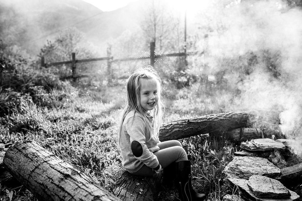 girl at the campfire in the smoke