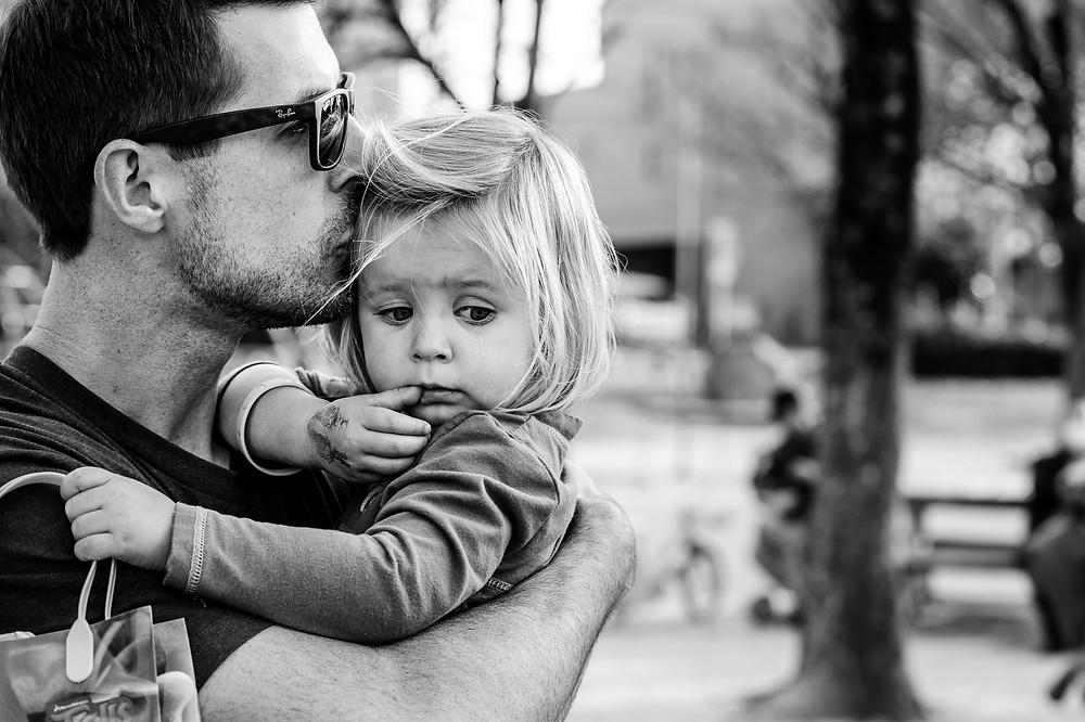 Justin kisses his little girl