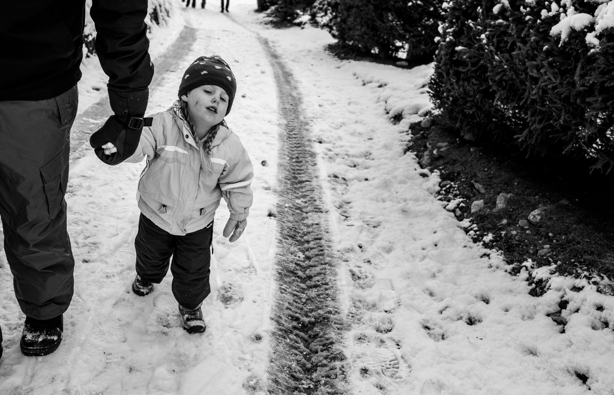 little girl really doesn't want to walk in the snow