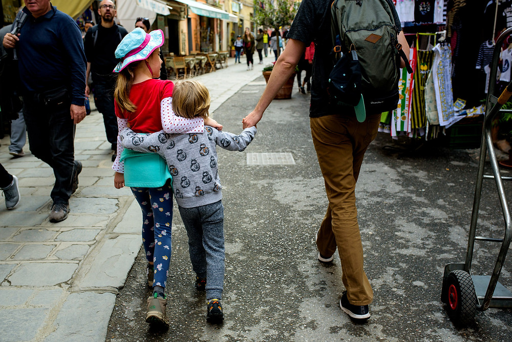 dean and Amelia hug while walking through Vernazza