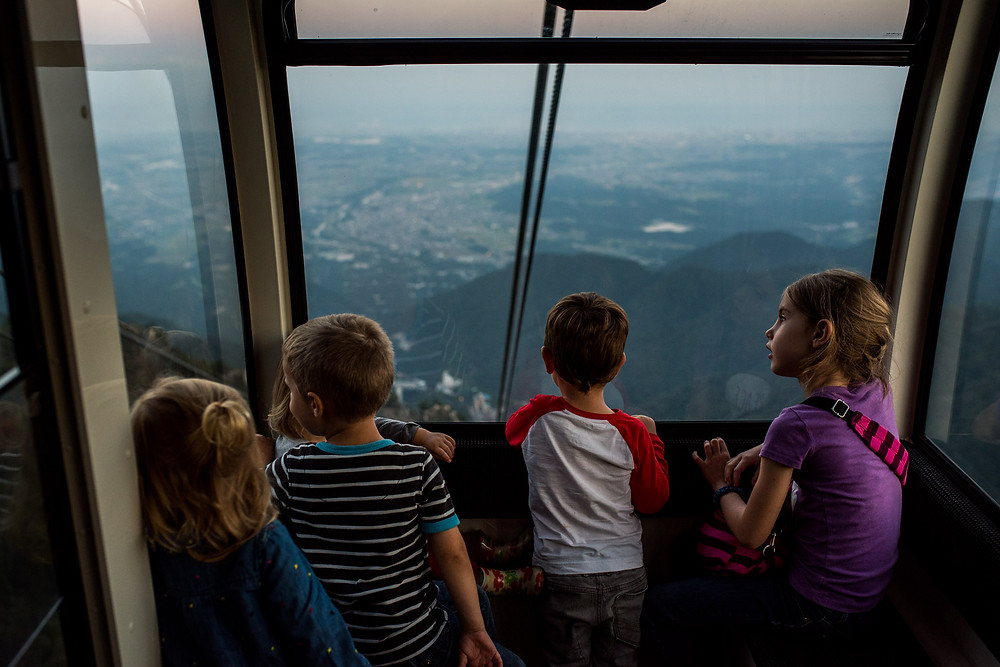 The kids watch as we go down the mountain via the longest ropeway in Japan.