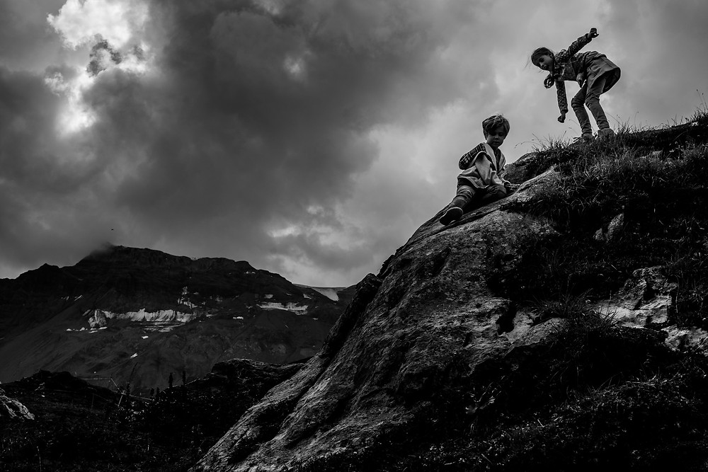 brother and sister climbing on a mountain