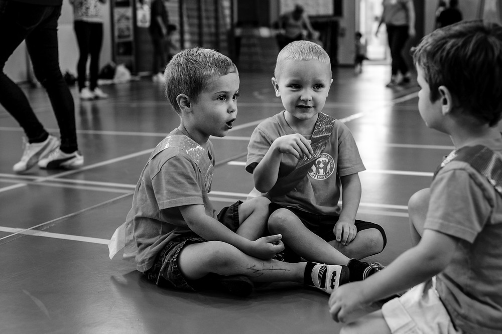 Liam and Dean and Parker talking at sports day