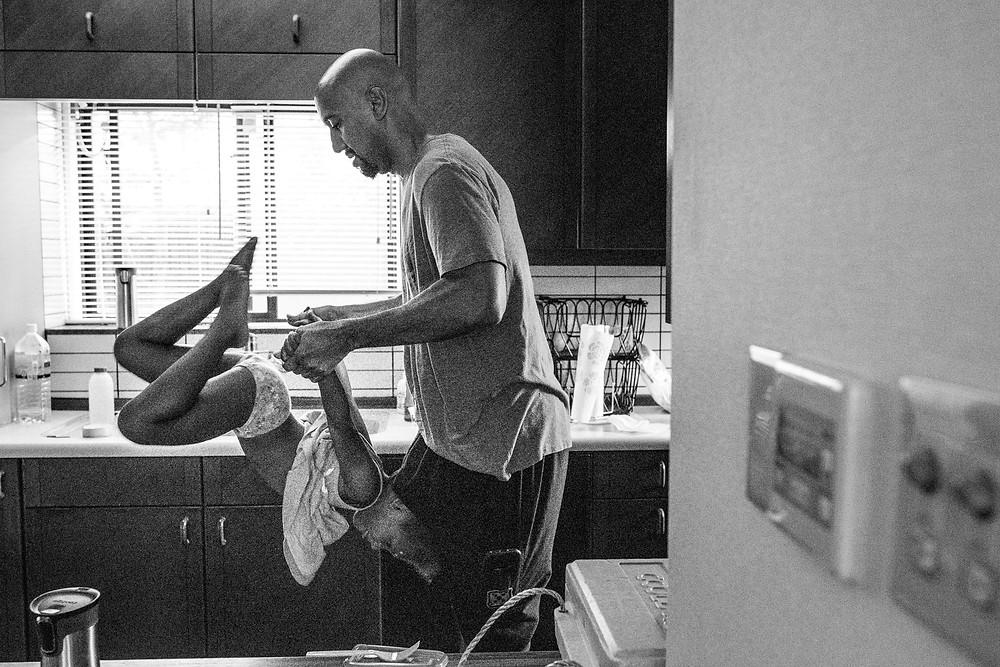 Dad flips his daughter around in the kitchen
