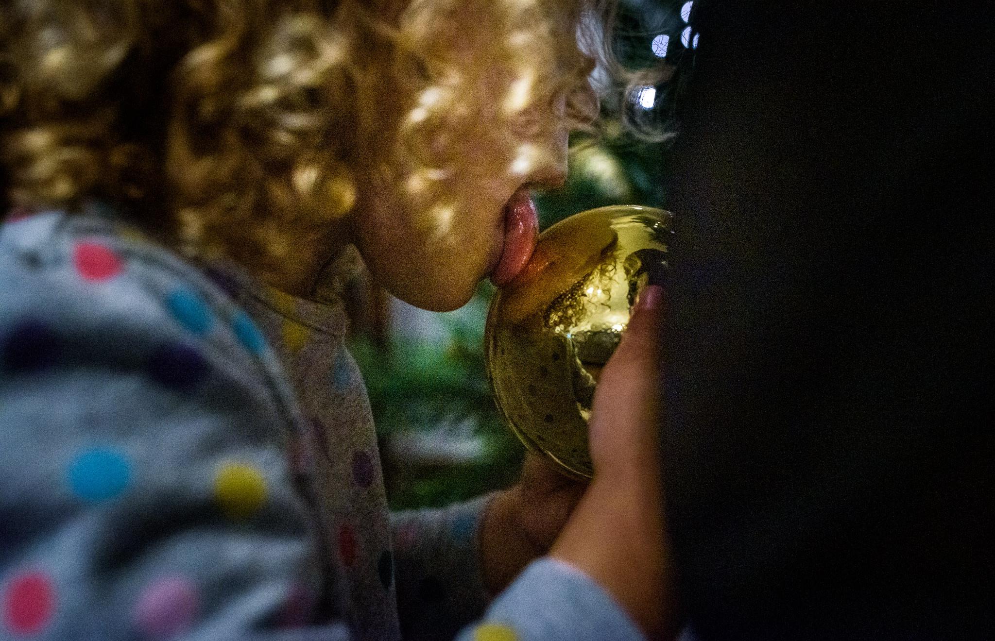 girl licks an ornament