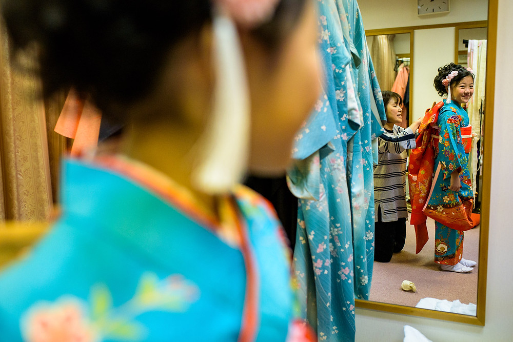 Val loves her pretty kimono, admires it as she looks in the mirror