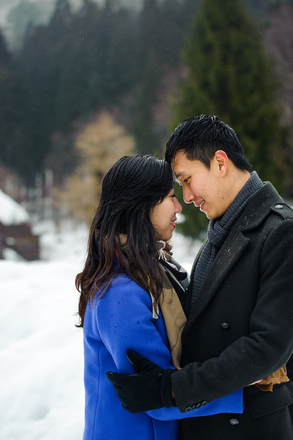 Sin looks lovingly at his fiancée in Shirakawago