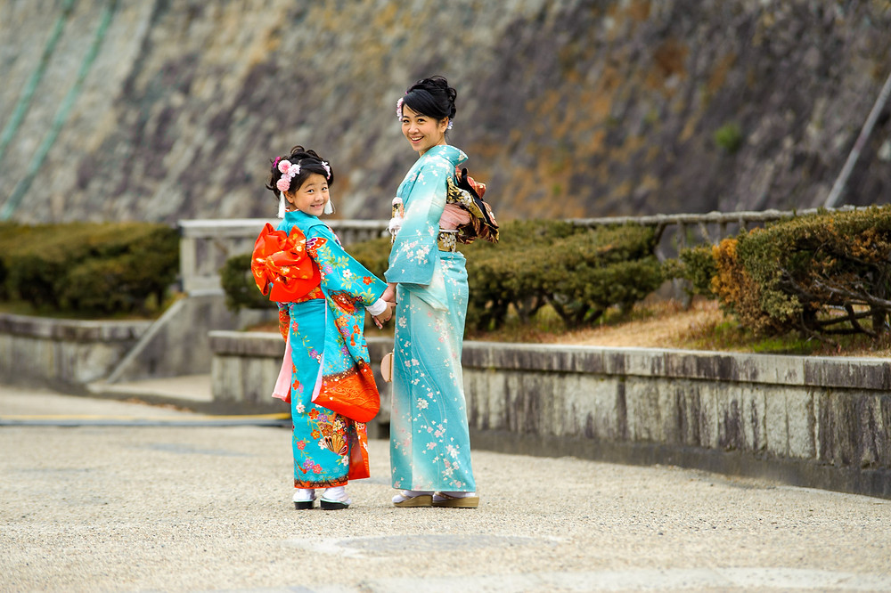 Carina and her daughter Val walk near the Nagoya castle moat in their kimonos