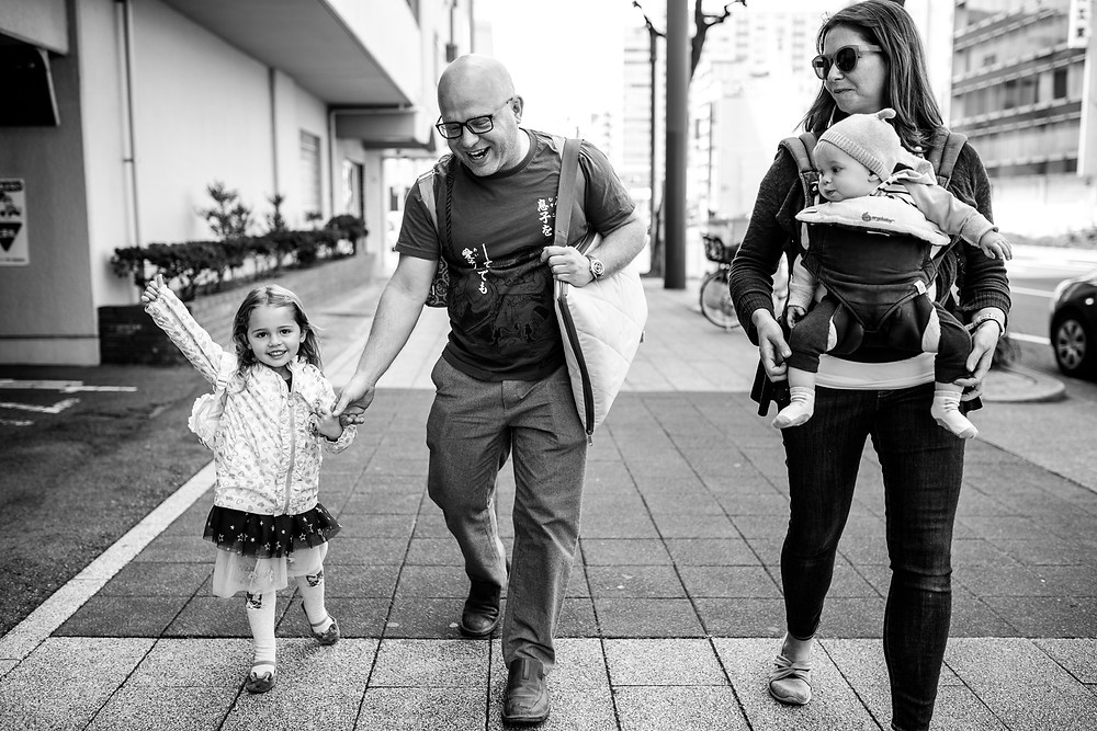 family takes a walk through the city