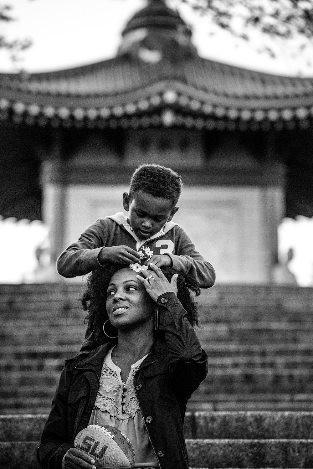 Jackson puts flowers in his mother's hair
