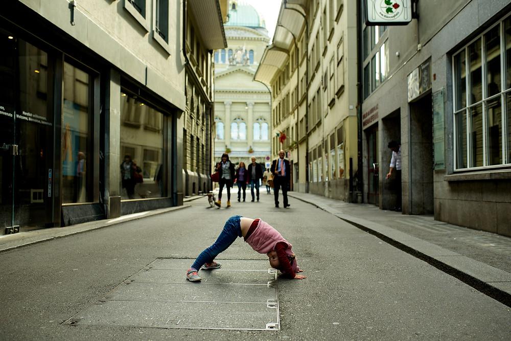 little girl doing downward dog