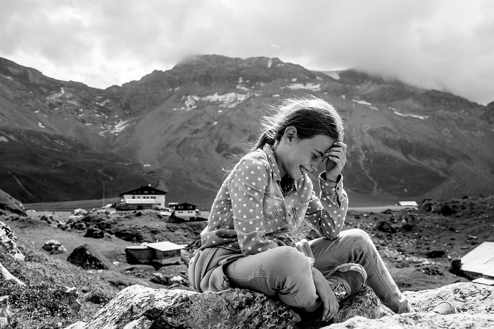 girl laughs in the mountains
