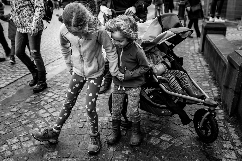 siblings playing on the street