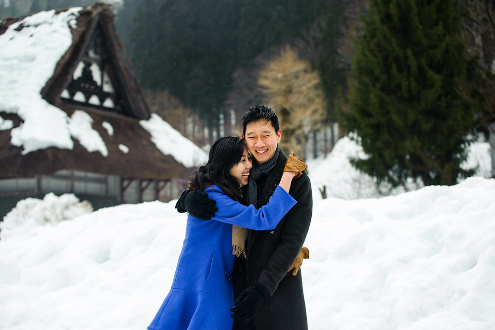 Mira and Sin laugh together in Shirakawago