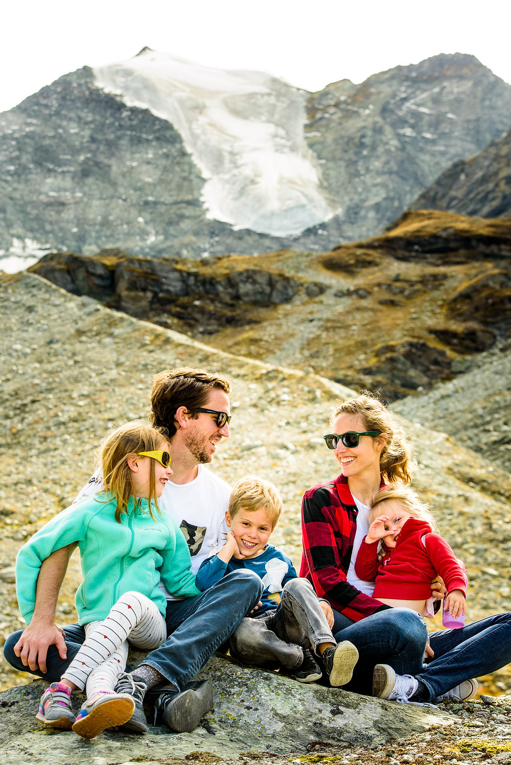 Our family in the mountains in front of a glacier