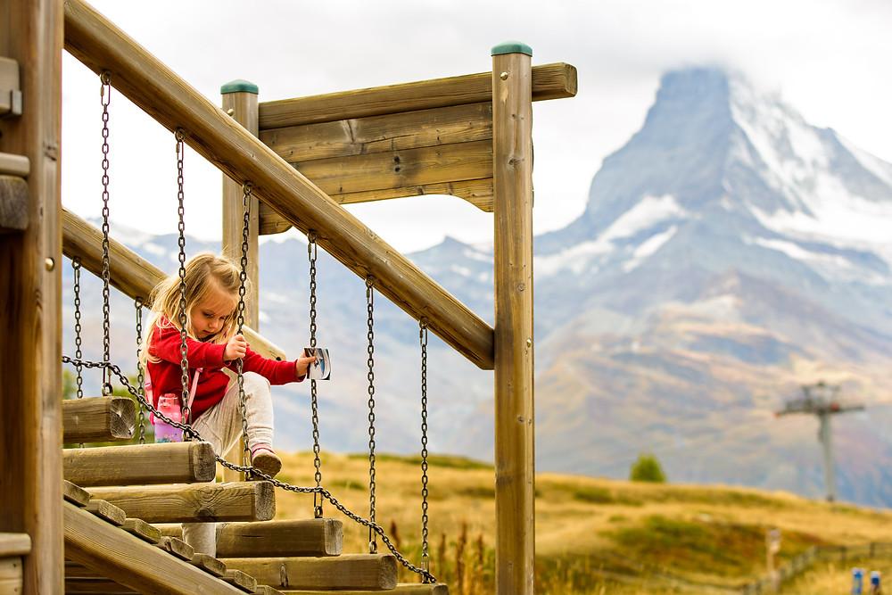 Skye playing at the matterhorn playground