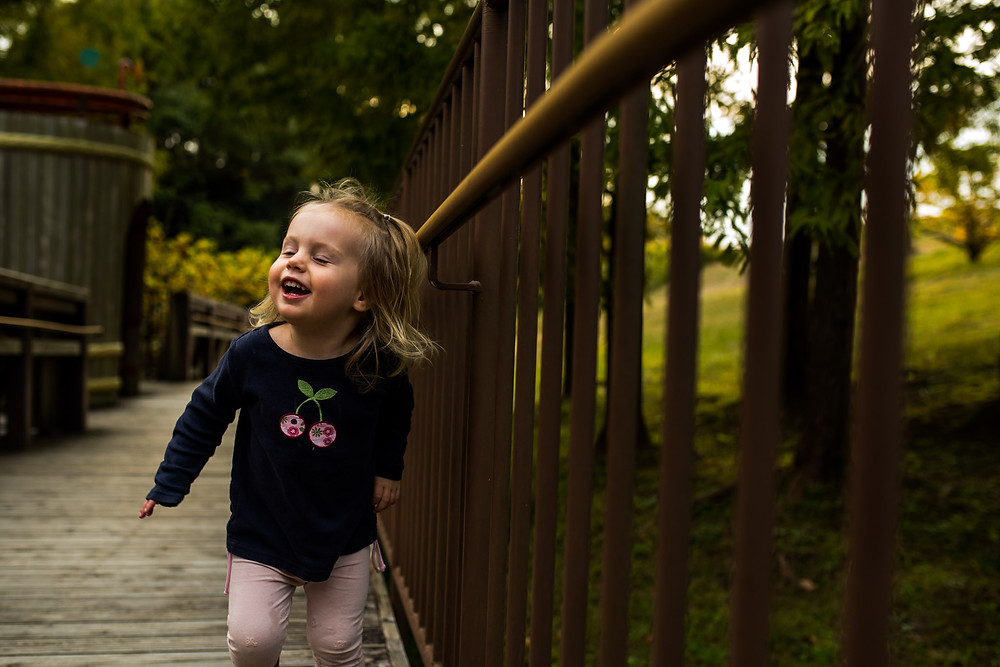 Skye laughs as she wanders up the walkway at Aichi Children's Center