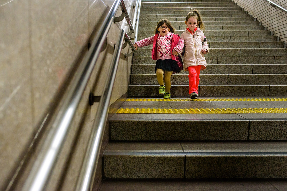 Bentley and her best friend in the subway station