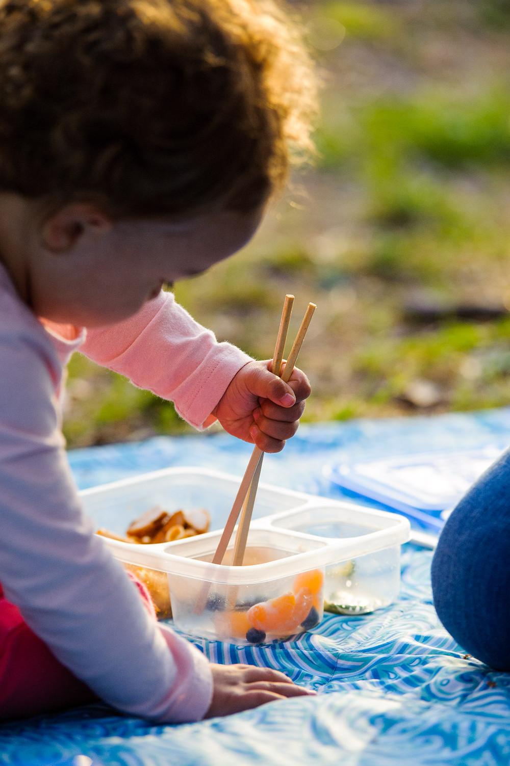 Gia eats with chopsticks