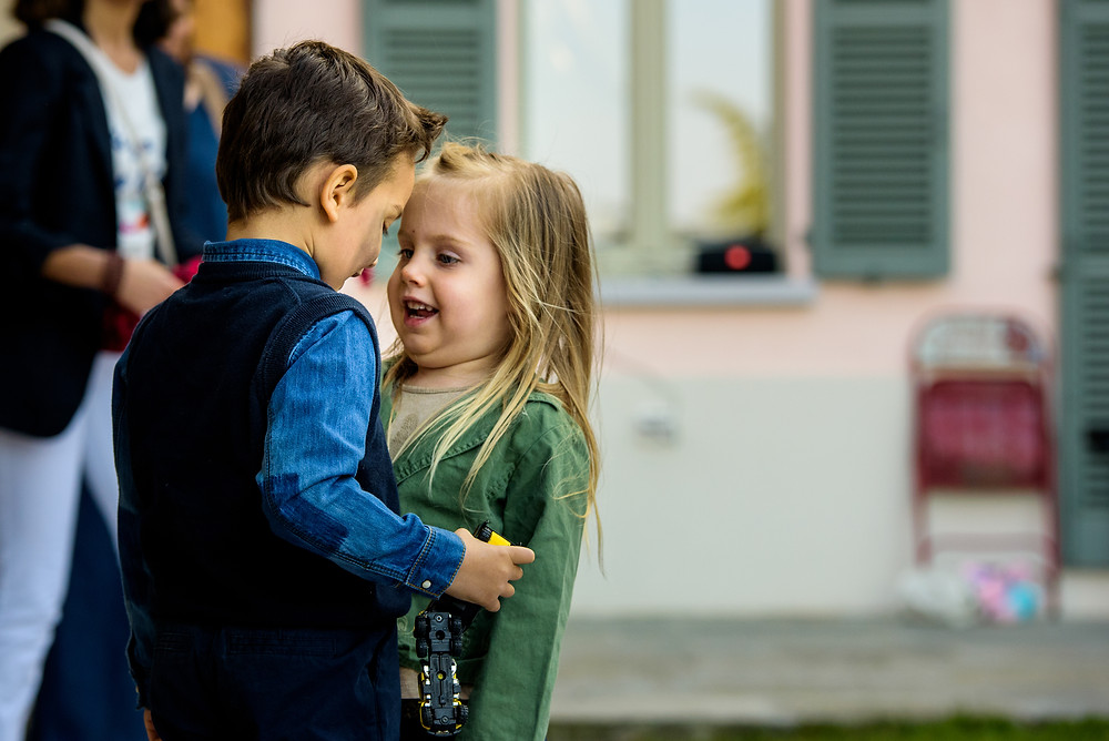 little boy and girl at a party