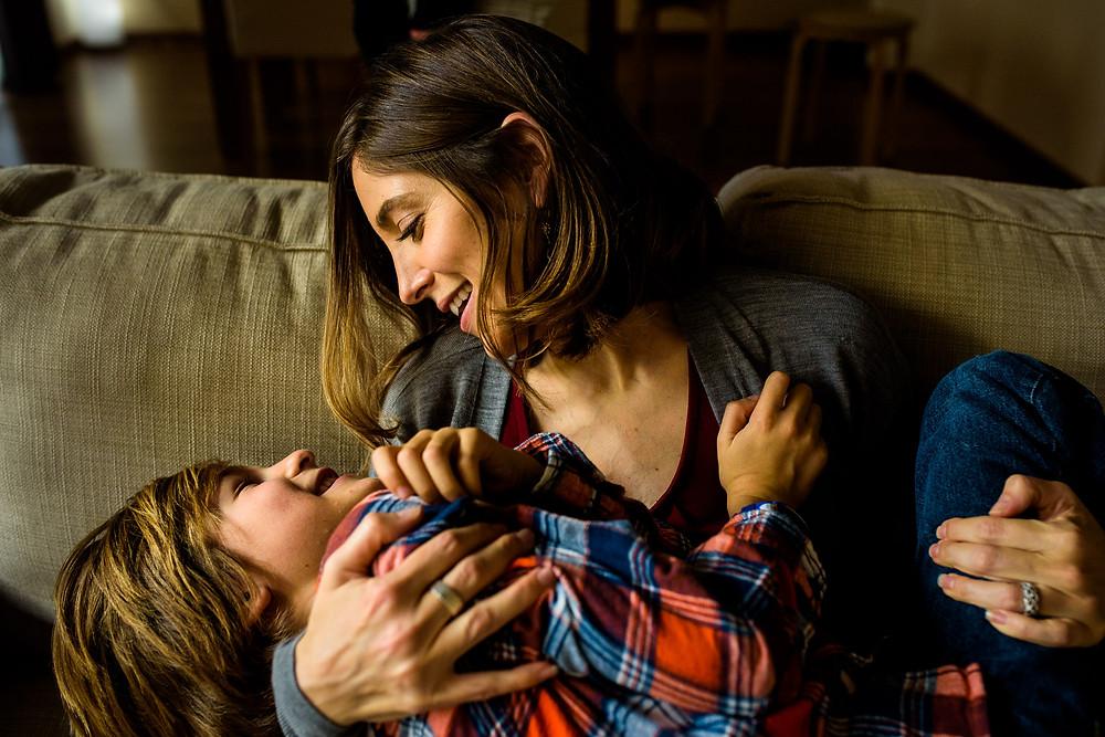 Nicole cradles Ezra lovingly on the couch