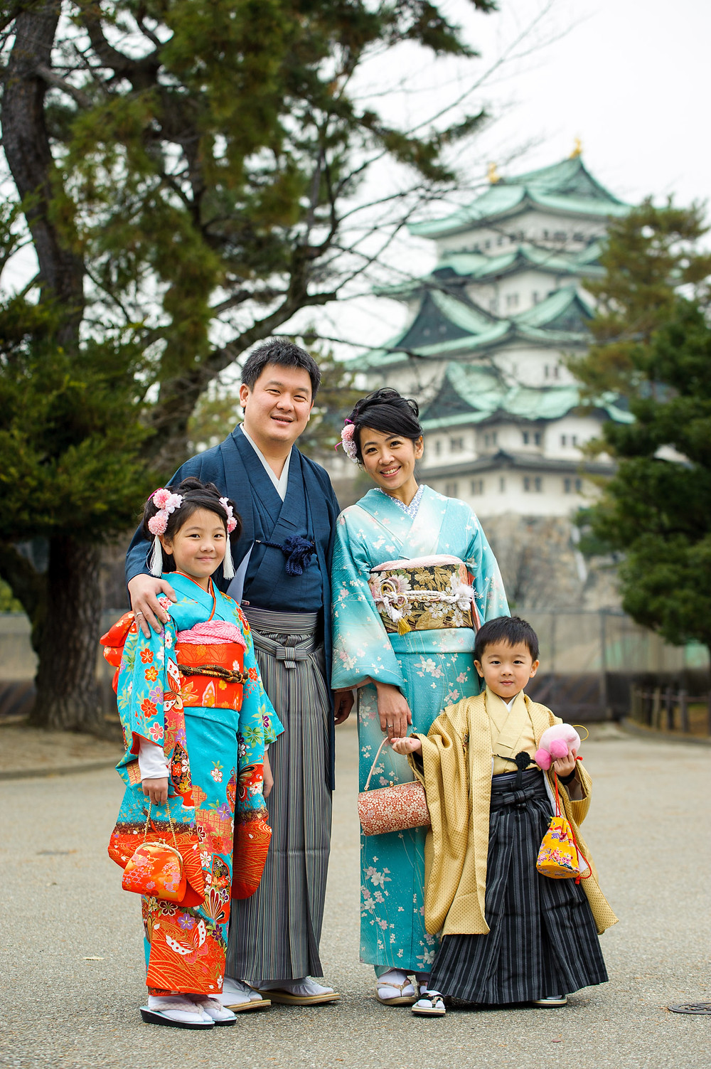 The Permana Family poses in front of the Nagoya castle in their kimonos