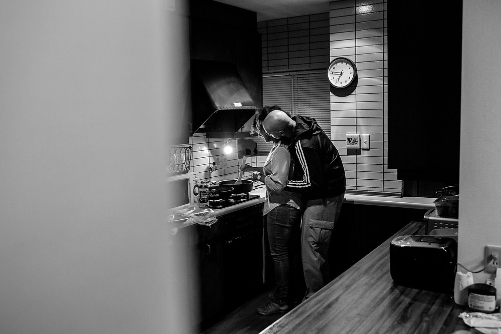embraces while cooking dinner