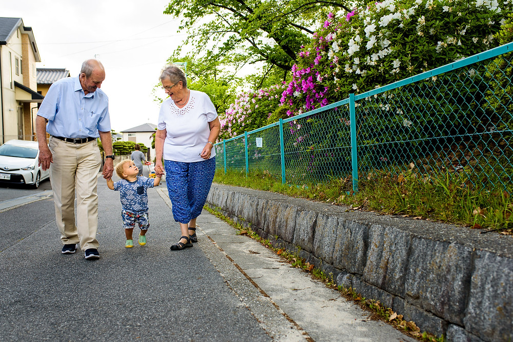 Max and his grandparents on a walk