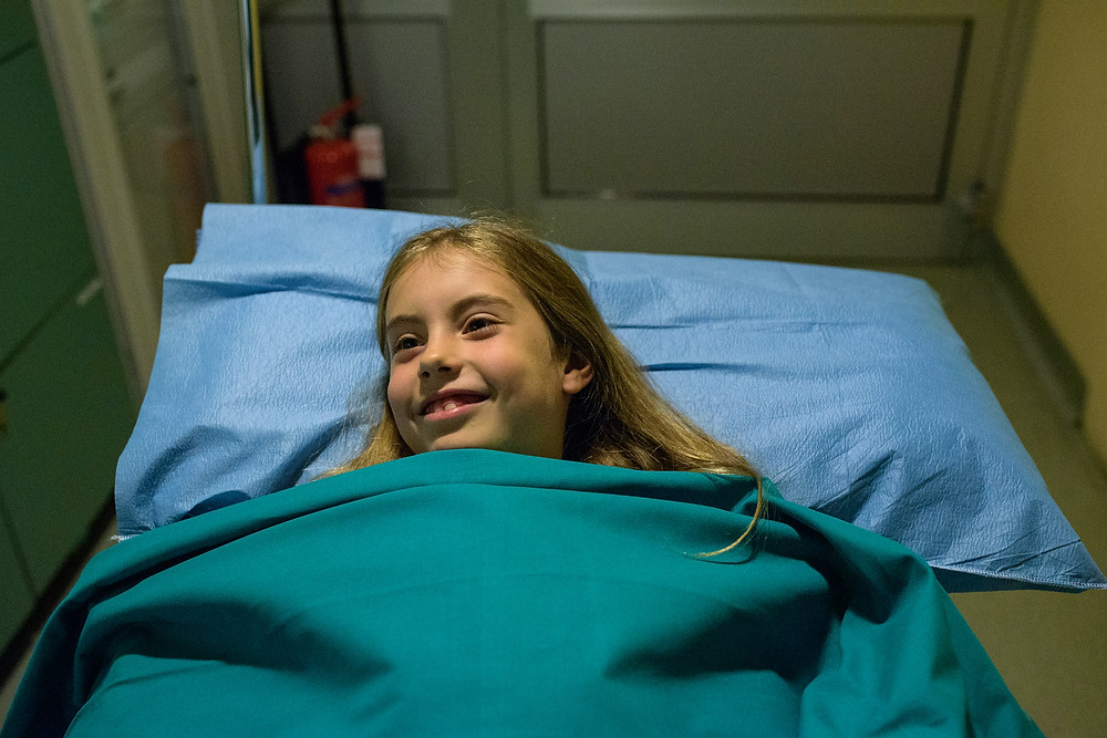 young girl with a brave face before surgery