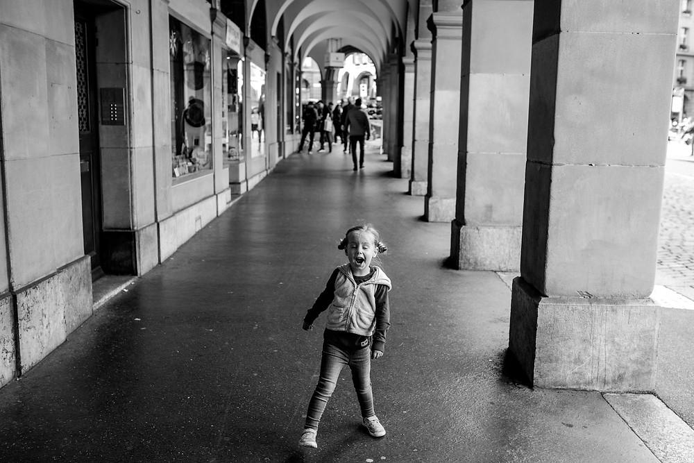 girl sings as she walks through town