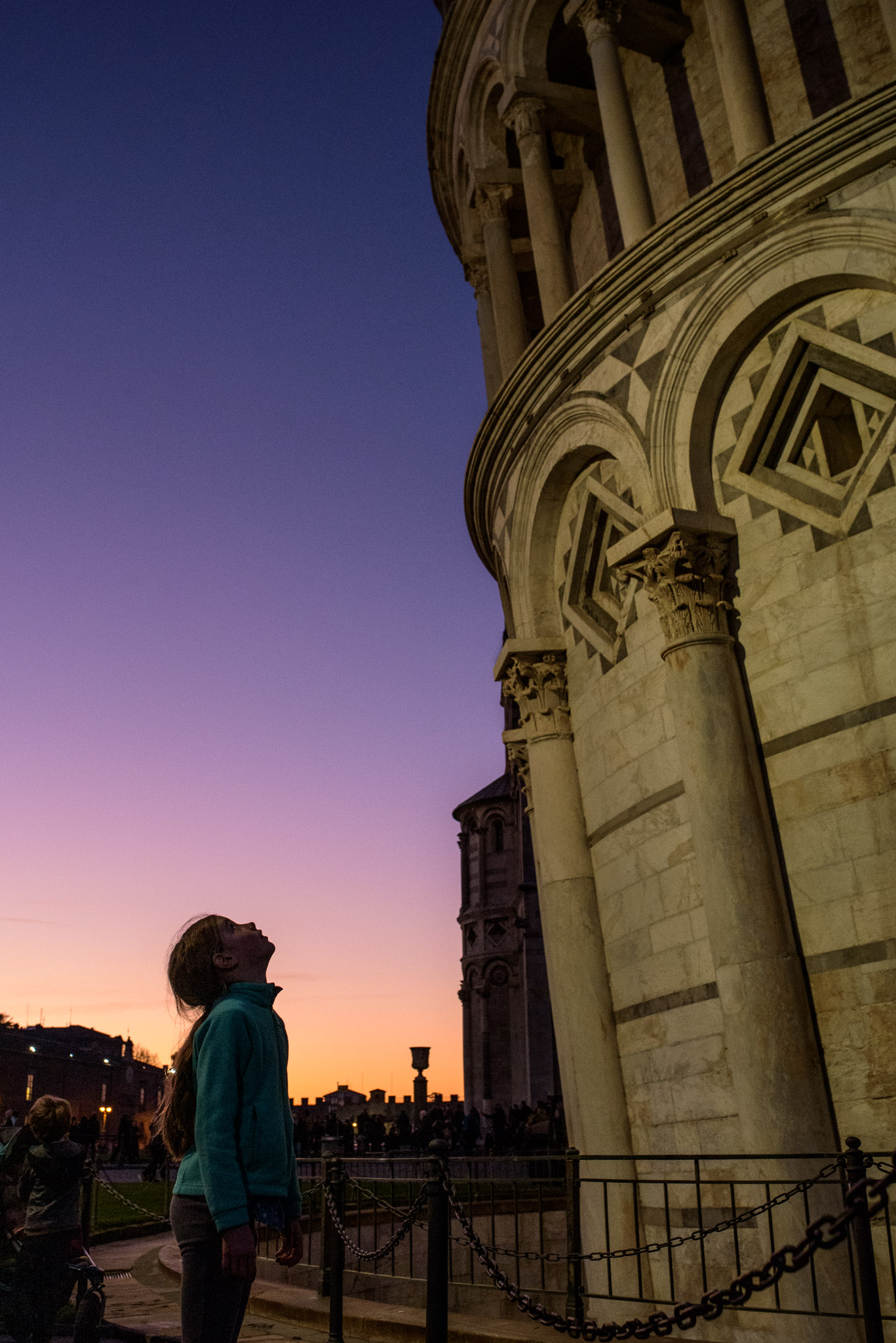 girl in awe of the leaning tower at sunset