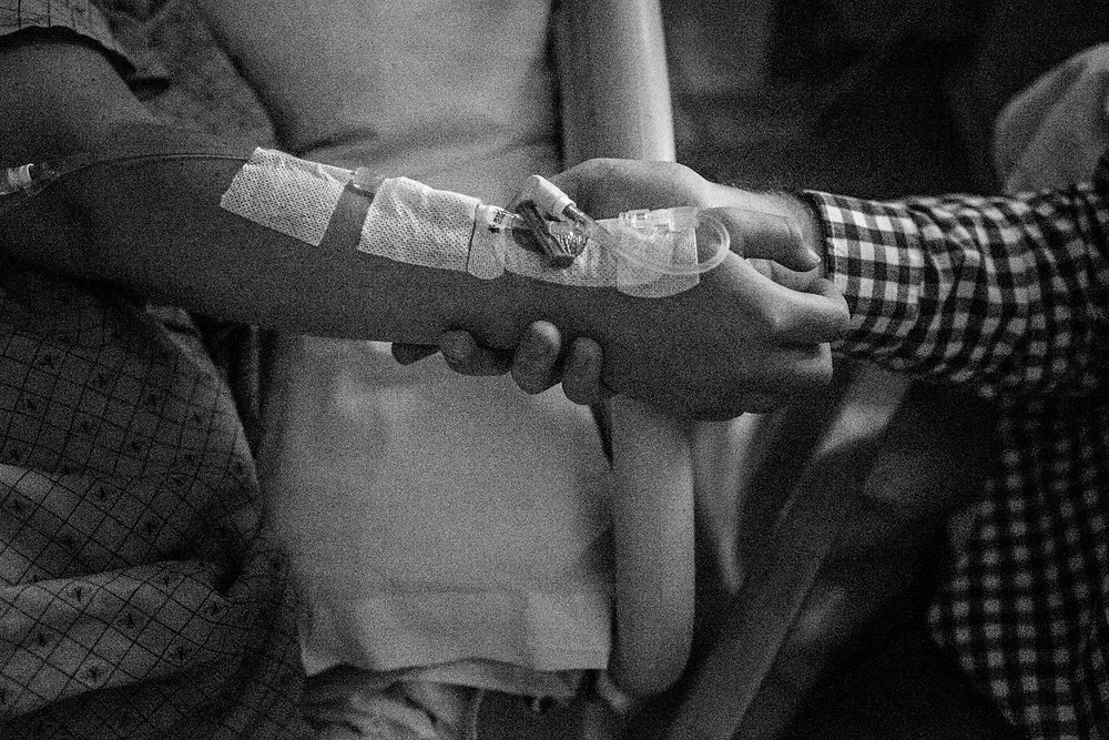 holding hands in the hospital