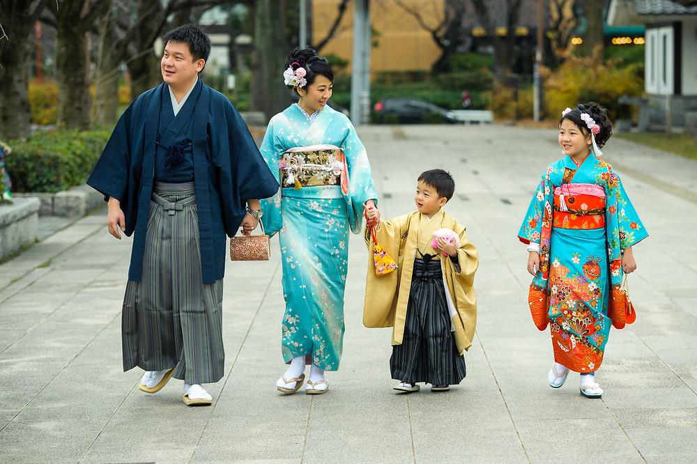 The Permana Family takes a walk through the city streets in their kimonos