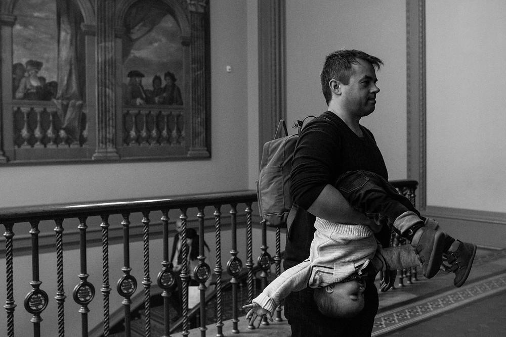 dad holding boy upside down