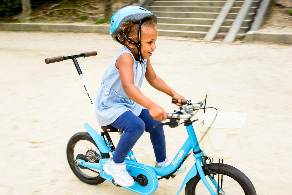 Addison rides her bike