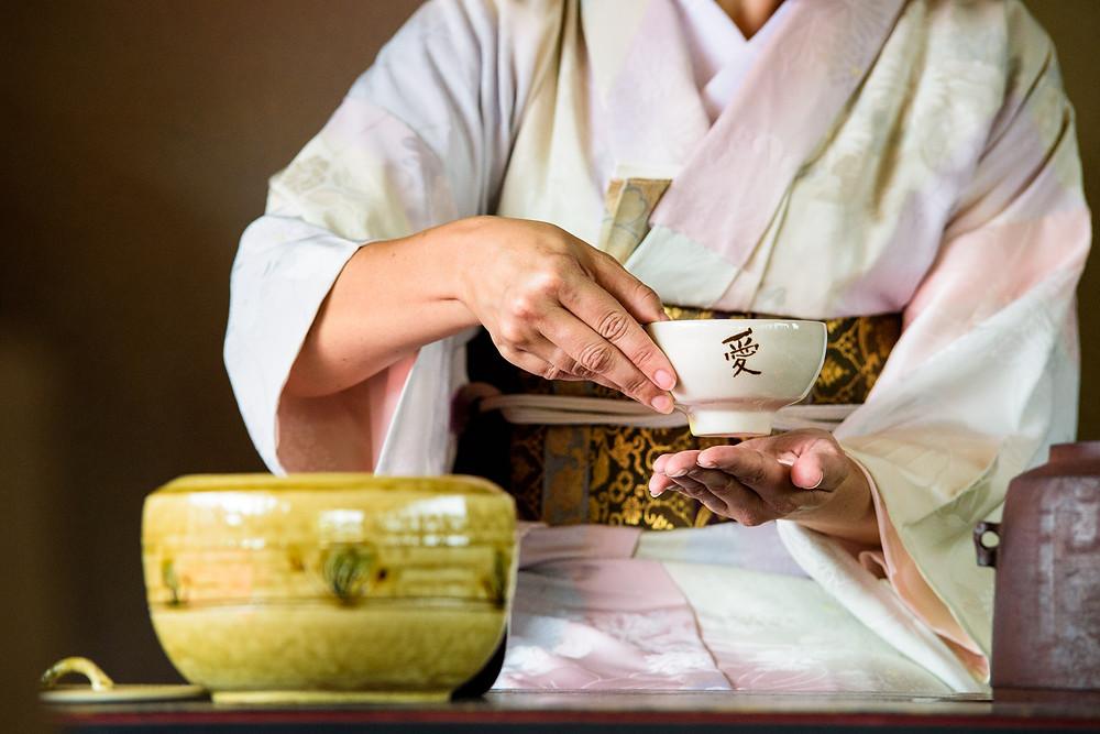 Brittney displays the tea cup