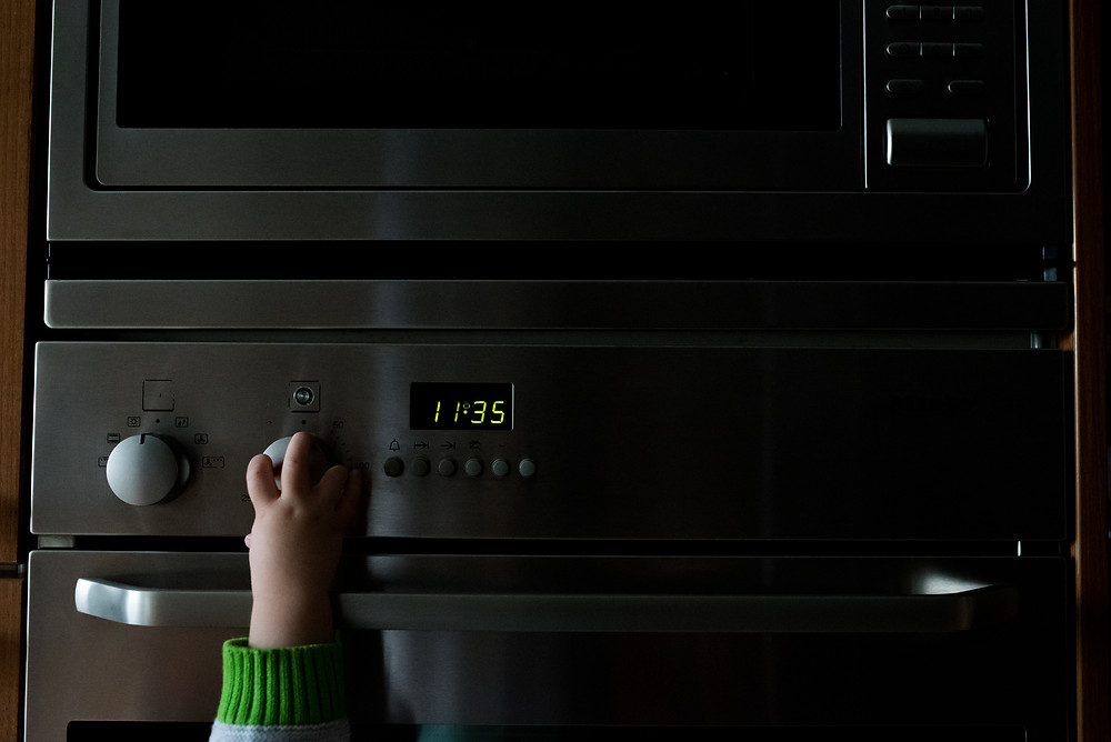 Toddler hand on the oven