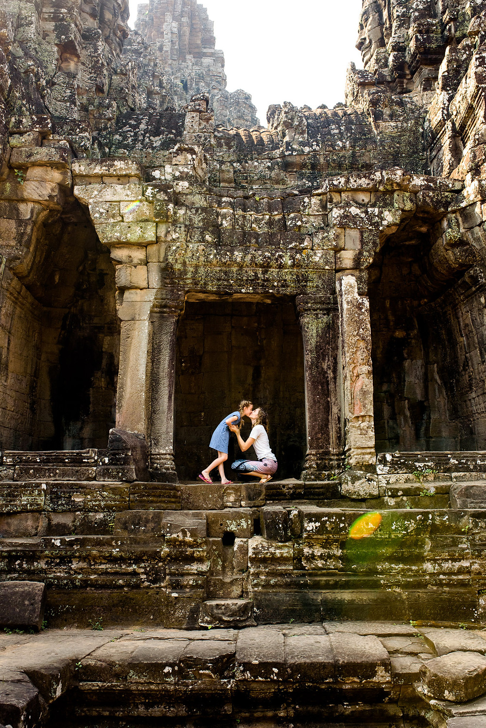 mom and daughter kiss at Angkor Wat