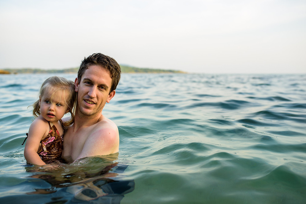 Brad holds Skye in the lovely ocean water