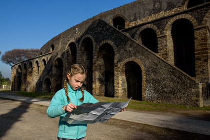 girl checking a map in Pompeii