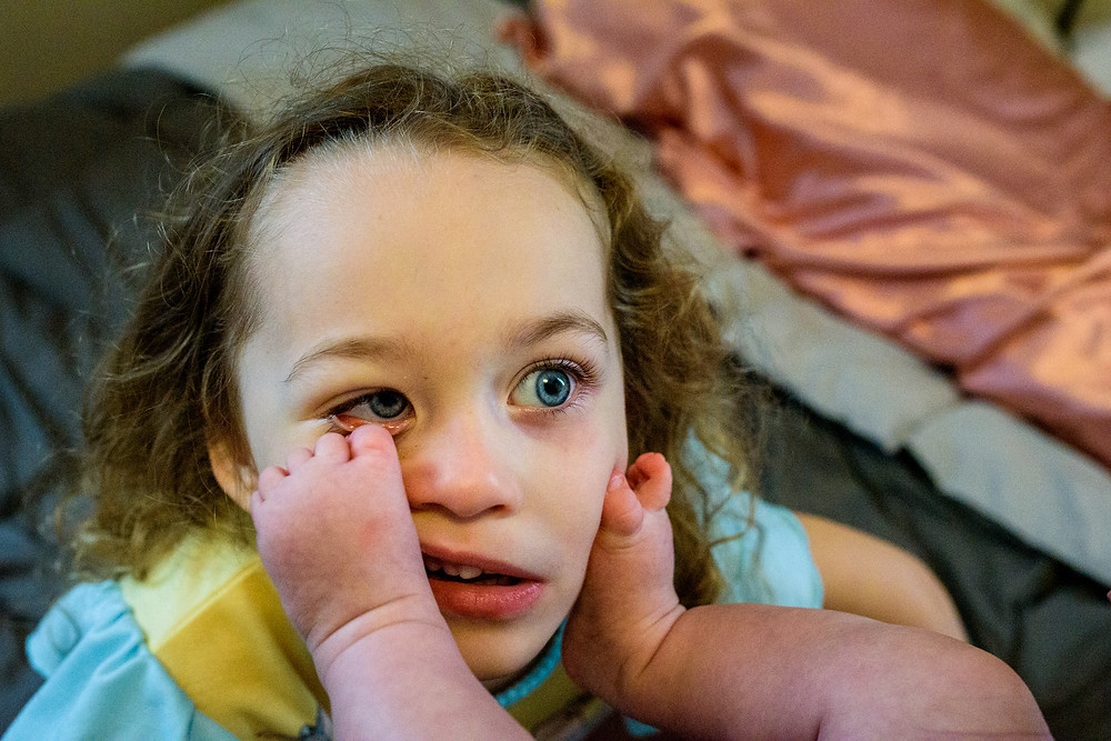 sister lets baby put her toes in her eyes