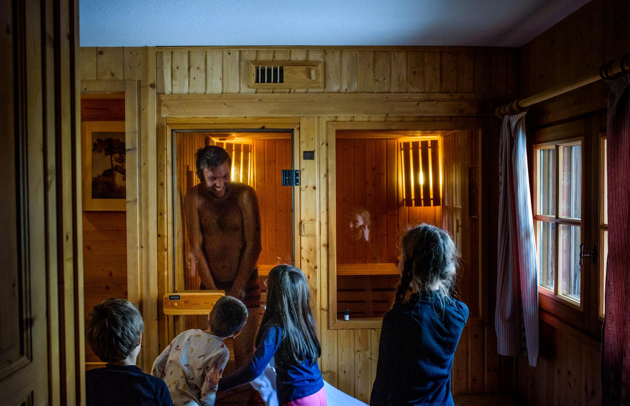 little kids peek on their uncle in the sauna in his underwear